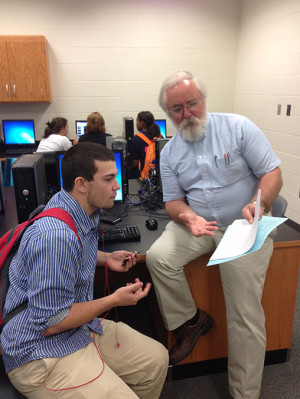 Senior Chase Piper talks with Mr. Clawson. Photo by Joshua Tiaga