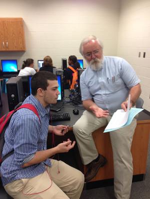 Senior Chase Piper talks with Mr. Clawson. Photo by Joshua Tiaga