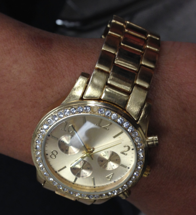 Senior Raquel Noel wearing a trendy watch.