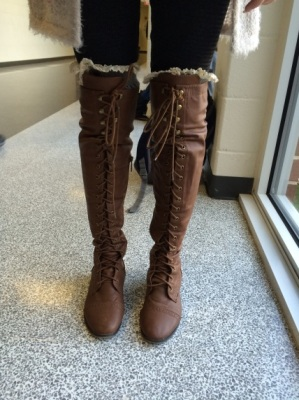 Senior Emily Carter wearing the popular trend of over-the-knee boots.