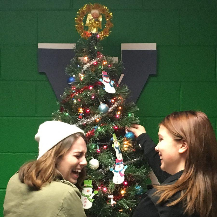 Seniors Ashley McMillan (left) and Sara Healy decorate the holiday tree in Woodgrove's guidance office.