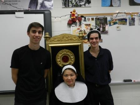 King Hamlet (CJ Hall) and Hamlet (Patrick Ramsey) pose with Ms. Sim during their Shakespeare party.