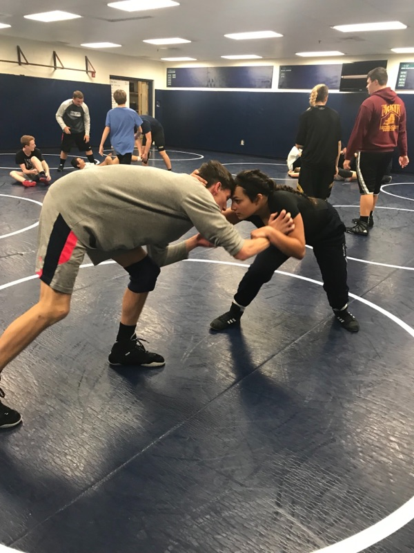 Sophomore Toni Charland wrestles her teammate at practice on December 4, 2017.