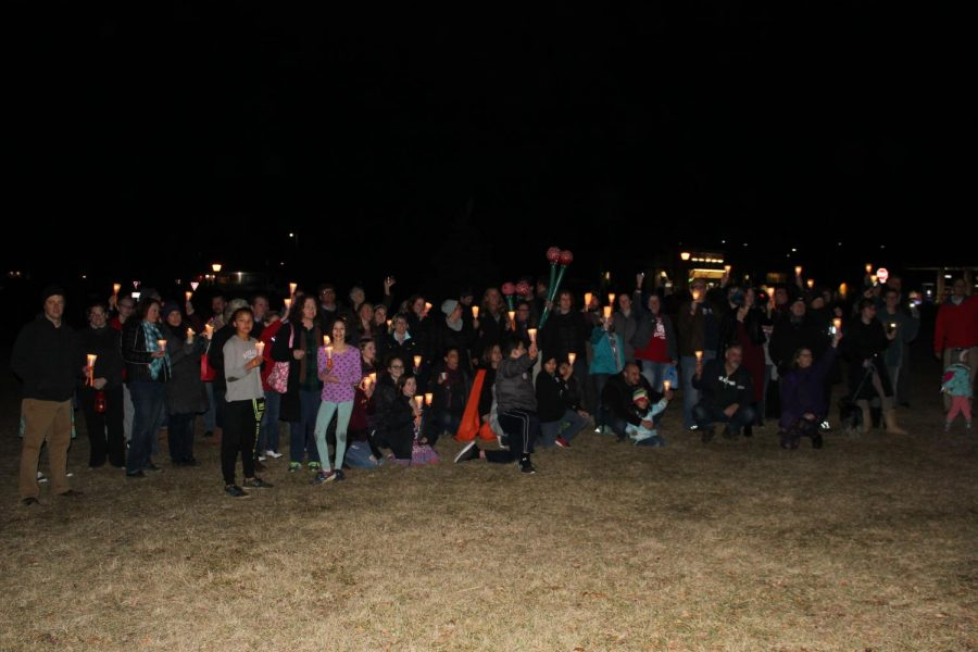 Lovettsville community members gather together with their makeshift candles.