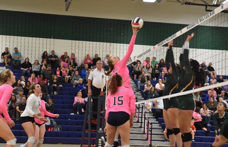 Senior Lauren Lynch spikes the ball against Loudoun Valley.