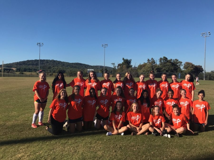 The Woodgrove Field Hockey Team poses for a picture before their annual Stick it to Cancer game.