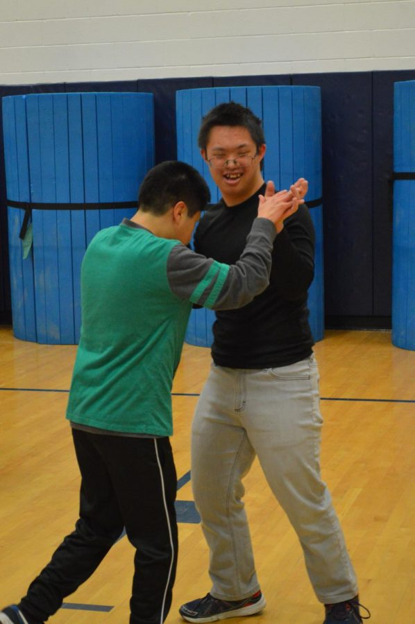 Partners Club Members Miguel and Justin exuberantly dance to prepare for the Partners Club Dance.