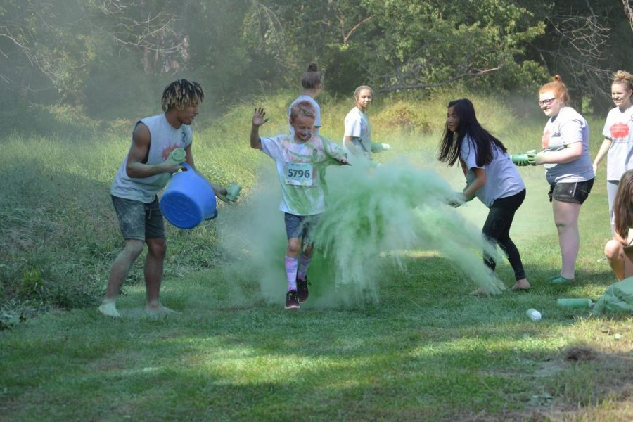 Color Run runners are splashed with the colorful powder while running.