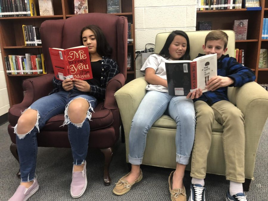 Freshmen Angela Gutierrez, Morgan Krens and Colin Heffern reading Me Before You and The Hate U Give.
