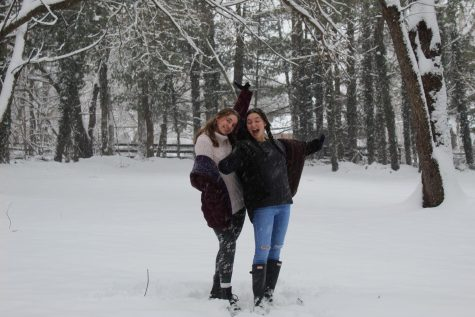 Carissa Vergeres and Mia Cammarota pose in the snow.
