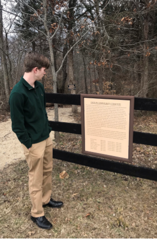 Junior Chris Tuttle visits Sycolin Cemetery.
