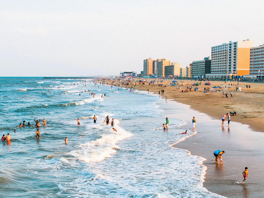People enjoy the Virginia Beach shore.