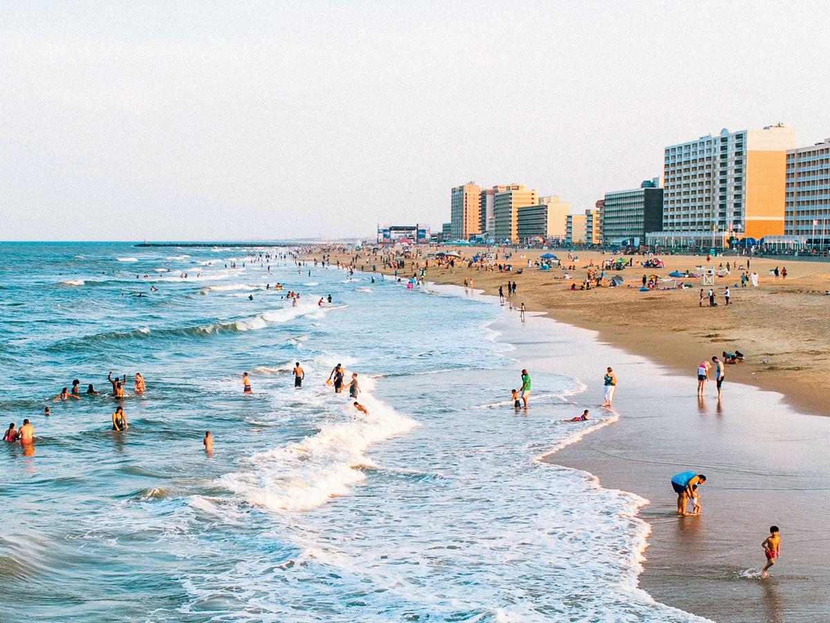 People enjoy the Virginia Beach shore.