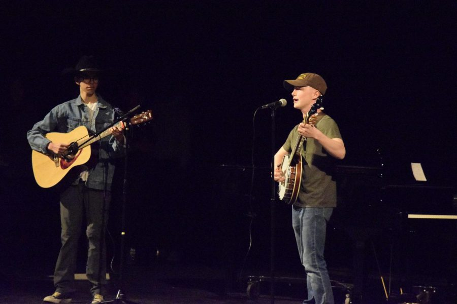 Photo by Lorallye Partlow. Brendon Hernandez and James Stevens sing John Denver's solo,
