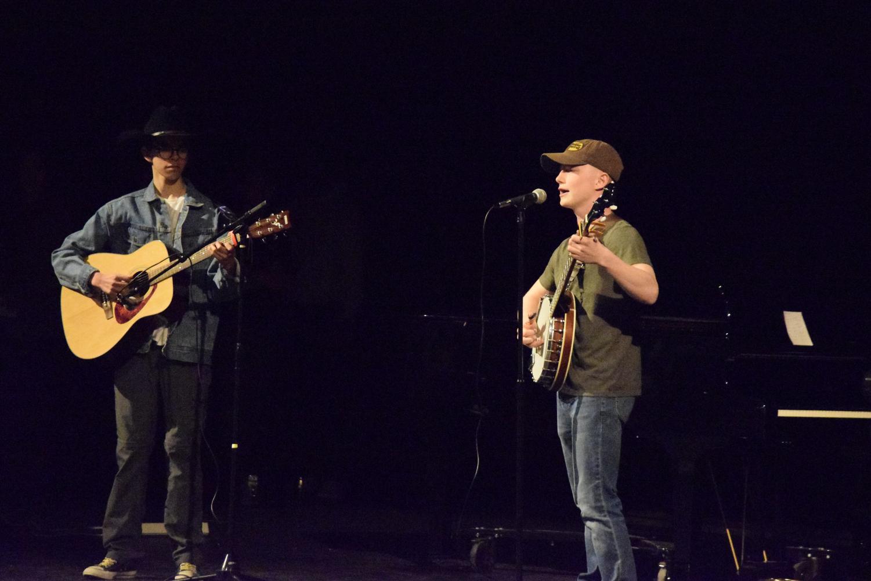 Photo by Lorallye Partlow. Brendon Hernandez and James Stevens sing John Denver's solo,