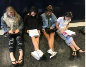 Juniors Jamie Prack, Maya Lombardo, Anna Lippert, and Hope Fahrner studying for AP classes. Photo taken by Annie Gilbert.