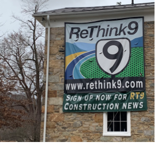 """Rethink9"" sign posted on the Hillsboro Old Stone School building."