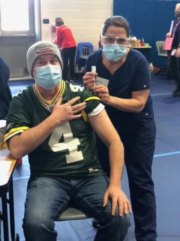 Harmony Middle School Principal Eric Stewart receiving his COVID-19 vaccination. Photo provided by Carissa Vergeres.