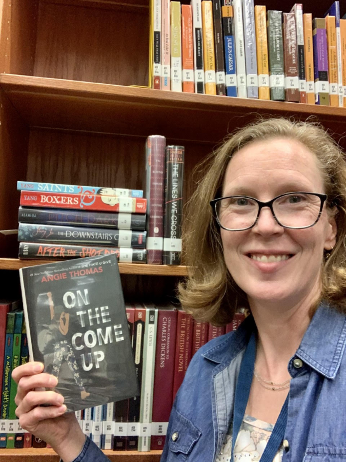 Ms. Emerson and one of her favorite books.