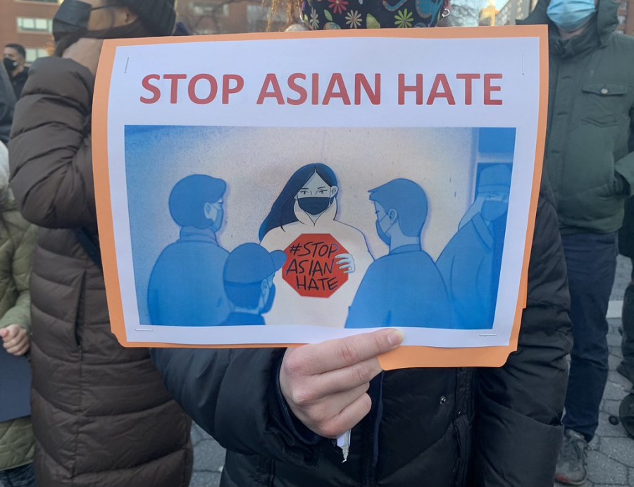 Protesters hold up an anti-Asian violence sign. Creative Commons